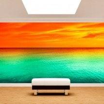 Foto muro murales tramonto sul mare