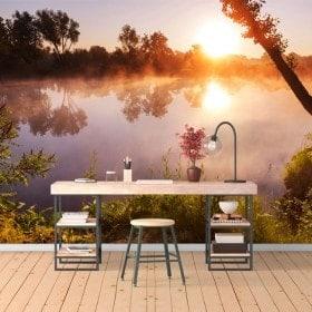 Foto muro murales tramonto sul fiume