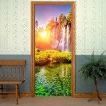 Porte in vinile decorative tramonto nelle cascate