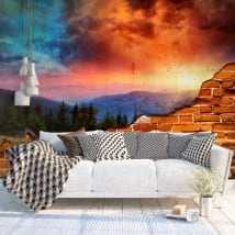 Murales in vinile montagne al tramonto effetto muro rotto