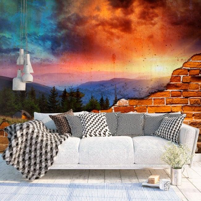 Gigantografie effetto muro rotto montagne al tramonto