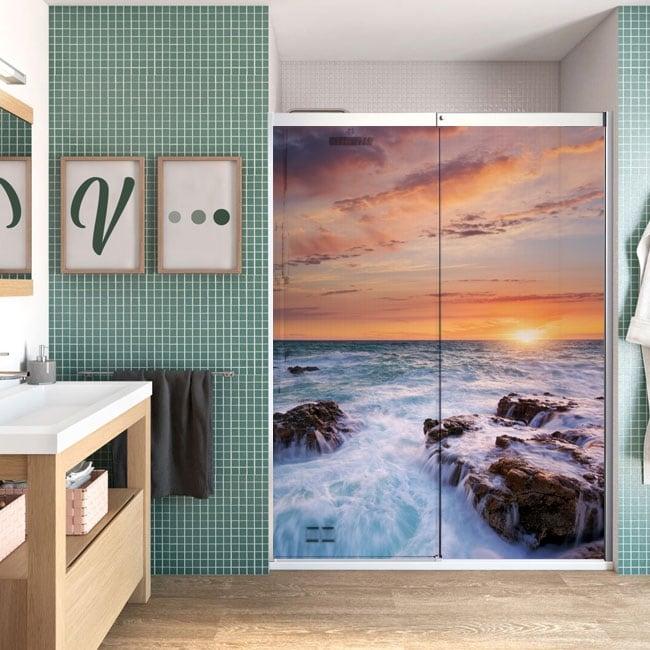 Vinili schermi del bagno tramonto sul mare